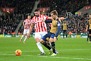Arsenal defender Nacho Monreal battles with Stoke City Striker Jonathan Walters during the Barclays Premier League match between Stoke City and Arsenal at the Britannia Stadium, Stoke-on-Trent, England on 17 January 2016. Photo by Alan Franklin.