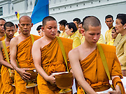 09 JUNE 2016 - BANGKOK, THAILAND: Buddhist monks file past alms givers during a special merit making ceremony at the Grand Palace in Bangkok. Thailand marked 70 years of the reign of Bhumibol Adulyadej, the King of Thailand, with a special alms giving ceremony for 770 monks in front of the Grand Palace in Bangkok. The King, also known as Rama IX, ascended the throne on 9 June 1946. He is the longest serving monarch in Thai history and the longest serving monarch in the world today. He is revered by most Thais and is widely seen as a unifying figure in the country.      PHOTO BY JACK KURTZ