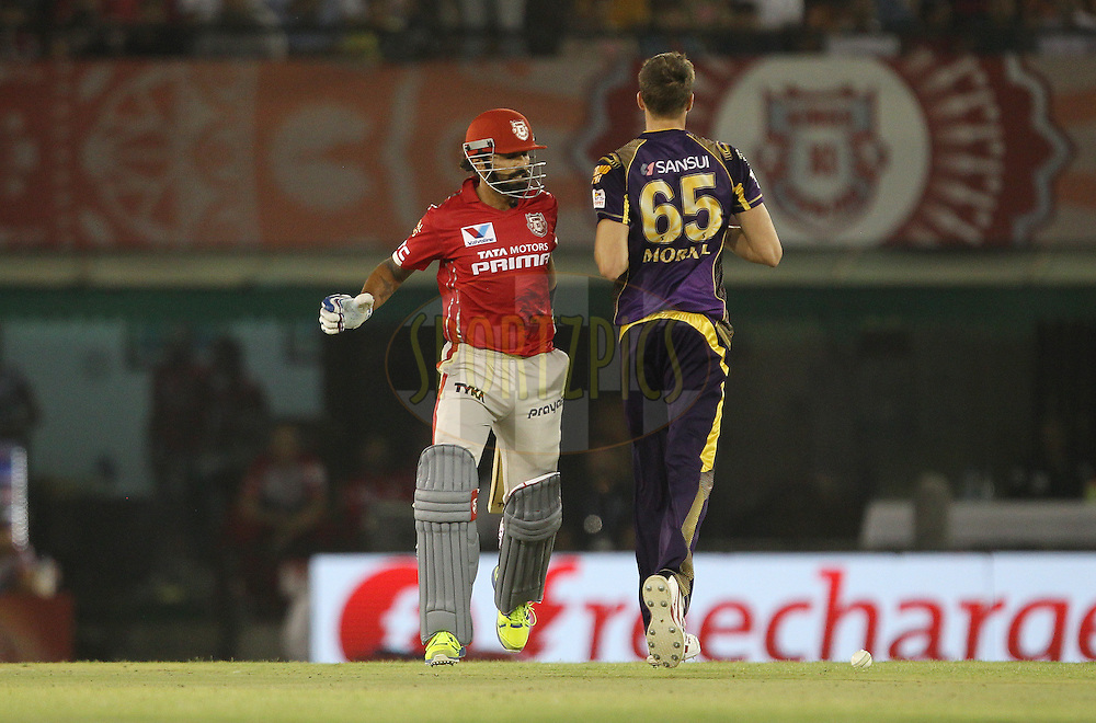 Murali Vijay of Kings XI Punjab and Morne Morkel of Kolkata Knight Riders almost clash during match 13 of the Vivo Indian Premier League ( IPL ) 2016 between the Kings XI Punjab and the Kolkata Knight Riders held at the IS Bindra Stadium, Mohali, India on the 19th April 2016<br /> <br /> Photo by Ron Gaunt / IPL/ SPORTZPICS