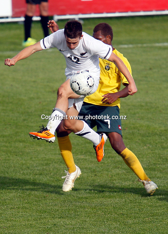 NZ's Louis Fenton goes up against Vanuatu's Roddy Lenga. OFC Men's Olympic Qualifier New Zealand 2012 Semi Final, New Zealand v Vanuatu, Owen Delany Park Taupo, Friday 23rd March 2012. Photo: Shane Wenzlick