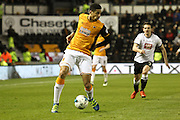 Hull defender Curtis Davies on the ball during the Sky Bet Championship match between Derby County and Hull City at the iPro Stadium, Derby, England on 5 April 2016. Photo by Aaron  Lupton.
