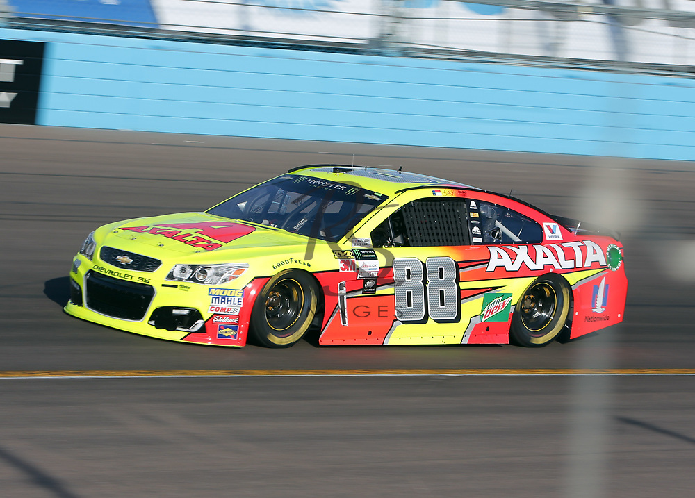 Dale Earnhardt Jr. qualifies for Sunday's NASCAR Cup Series auto race on Friday, March 17, 2017, in Avondale, Ariz.  (AP Photo/Rick Scuteri)