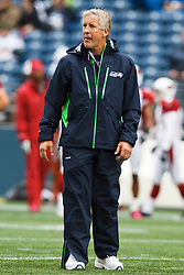 October 24, 2010; Seattle, WA, USA;  Seattle Seahawks head coach Pete Carroll watches his team warm up before the game against the Arizona Cardinals at Qwest Field.