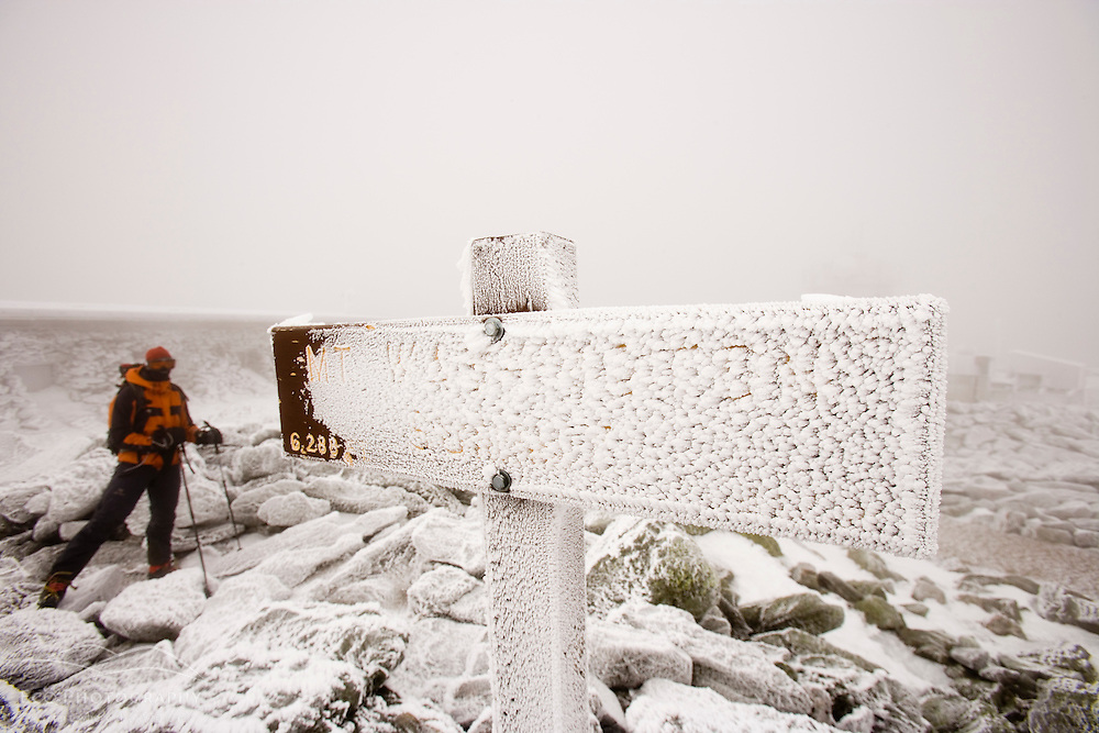 A hiker on the rime-ice covered summit of Mount Washington in New Hampshire's White Mountains.  March. (MR)