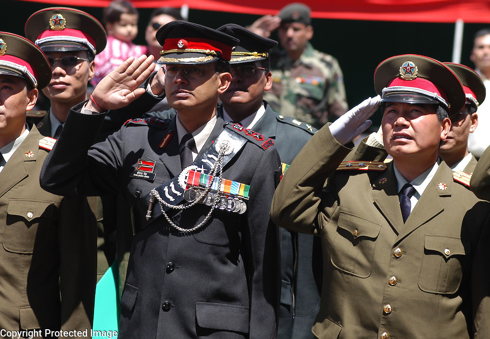 .Chinese Army personnel take salute along with Indian Army during the celebration of India's 60th Independence Day celebration in Bumla, at a hight of 15,000 in the Indo-China international border in Arunachal Pradesh on Tuesday, August 15, 2006. An official deligation of Chinese officers and soldiers accompanied by their families joined in the Independence Day celebrations with their Indian counterparts. This event is a positive step towards further cementing the ongoing efforts for improving relationships between ancient civilizations, who are emerging as major partners in developing the Asian region.            .
