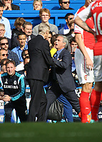 Football - 2014 / 2015 Premier League - Chelsea vs. Arsenal<br /> <br /> José Mourinho, Manager, of Chelsea FC and Arsene Wenger,Manager, of Arsenal FC get physical at Stamford Bridge<br /> <br /> Colorsport/Daniel Bearham