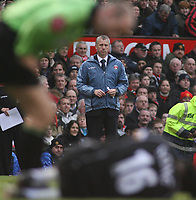Photo: Paul Thomas.<br /> Manchester United v Charlton Athletic. The Barclays Premiership. 10/02/2007.<br /> <br /> Charlton manager Alan Pardew watches on as referee Mike Riley checks to see if Charlton's Alexandre Song (Ground) is ok.