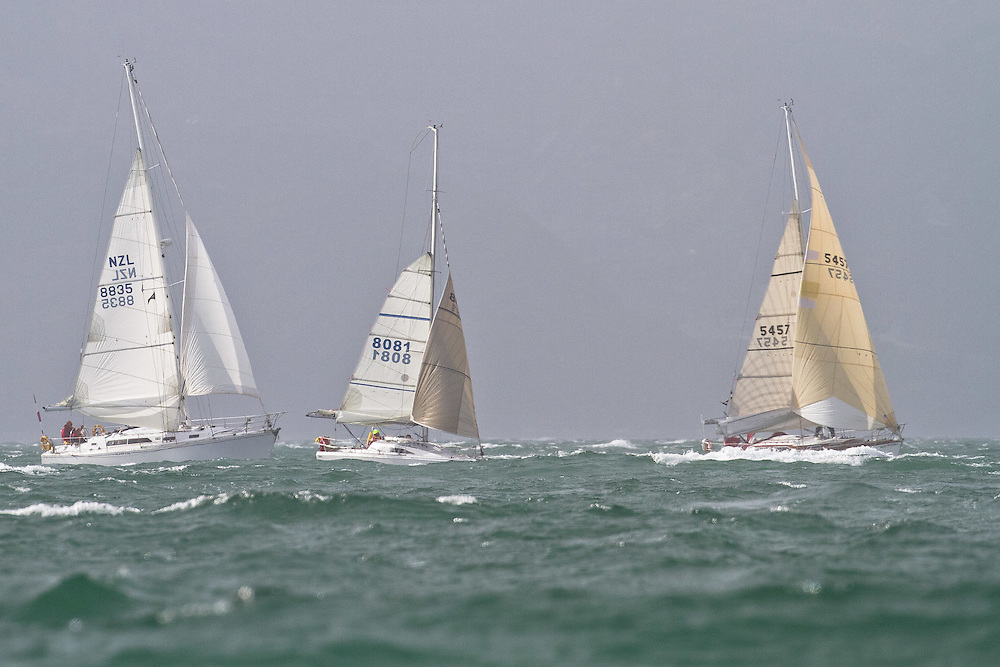 The fleet leave Wellington in plenty of wind at the Wellington restart of Round North Island two-handed yacht race. Wellington, New Zealand. 2 March 2011. Photo: Gareth Cooke/Subzero Images