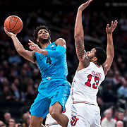 January 9, 2018, New York, NY : Georgetown's Jagan Mosely (4), left, and St. John's Marvin Clark II (13) go up for a shot during Tuesday night's matchup between the Hoyas and Red Storm at the Garden. In something of a rematch of their 1985 contest, Basketball greats Patrick Ewing and Chris Mullin returned to Madison Square Garden on Tuesday night to face off as coaches with their respective Georgetown and St. John's teams.  CREDIT: Karsten Moran for The New York Times
