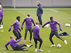 Manchester City's Vincent Kompany slide tackles during the training session at the Etihad Campus ahead of the UEFA Champions League second leg match against FC Barcelona - Photo mandatory by-line: Matt McNulty/JMP - Mobile: 07966 386802 - 17/03/2015 - SPORT - Football - Manchester - Etihad Campus - Barcelona v Manchester City - UEFA Champions League