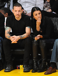 ©2011 GAMEPIKS 310-828-3445<br /> <br /> Linkin Park lead singer Chester Bennington and his wife Talinda Bentley sits courtside as he attends the Los Angeles Lakers/Portland Trail Blazers NBA game at Staples Center in Los Angeles on March 20, 2011. The Lakers defeated the Blazers 84-80.<br /> <br /> XYZ (Mega Agency TagID: MEGAR32159_6.jpg) [Photo via Mega Agency]