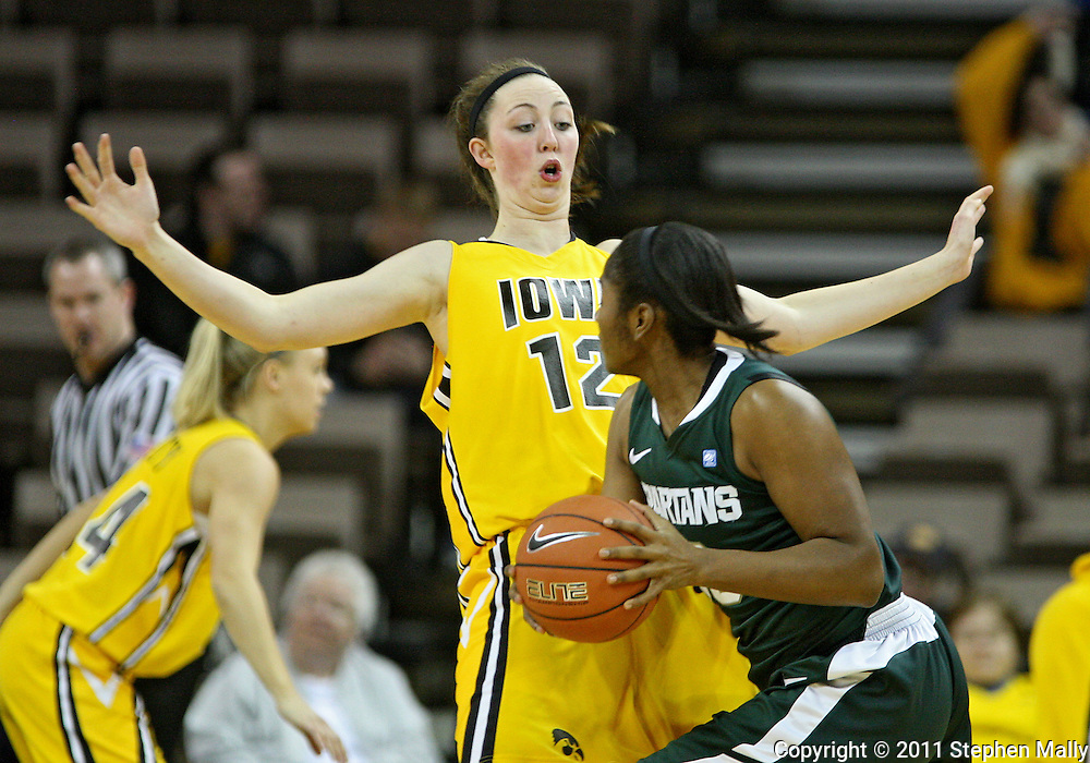 January 27 2010: Iowa center Morgan Johnson (12)] backs away from Michigan St. forward Lykendra Johnson (30) during the first half of an NCAA women's college basketball game at Carver-Hawkeye Arena in Iowa City, Iowa on January 27, 2010. Iowa defeated Michigan State 66-64.