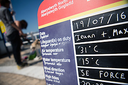 © Licensed to London News Pictures. 19/07/2016. Aberystwyth, Wales, UK. A sign shows the temperatures at the seaside in Aberystwyth, on the hottest day of the year so far. The temperature is set to reach the mid 30's centigrade in parts of the south east of the UK today, before heavy thunderstorms sweep in on Wednesday .  Photo credit: Keith Morris/LNP