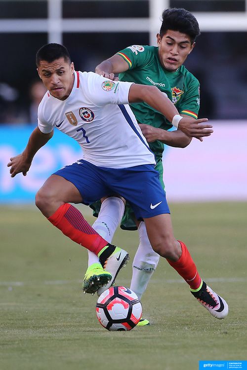 FOXBOROUGH, MASSACHUSETTS - JUNE 10: Alexis Sanchez #7 of Chile is found by Erwin Saavedra #2 of Bolivia  in action during the Chile Vs Bolivia Group D match of the Copa America Centenario USA 2016 Tournament at Gillette Stadium on June 10, 2016 in Foxborough, Massachusetts. (Photo by Tim Clayton/Corbis via Getty Images)
