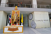 Thonglor (Sukhumvit Soi 55), at this time Bangkok's most fashionable area. Life Style Gallery (shopping centre) construction site. Portrait to commemorate the birthday of his majesty King Bhumipol Adulyadej on December 5.