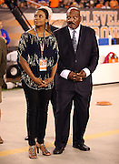 Former Cleveland Browns running back Jim Brown stands with his wife, Monique Brown, on the night he is honored by the team for his athletic efforts during his playing career at the Cleveland Browns NFL week 5 football game against the Buffalo Bills on Thursday, Oct. 3, 2013 in Cleveland. The Browns won the game 37-24. ©Paul Anthony Spinelli