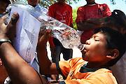 Guarani boy drinking clean water in Gutierrez, Santa Cruz, Bolivia