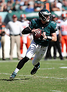 Philadelphia Eagles quarterback Carson Wentz (11) scrambles and throws a third quarter pass for a first down in Cleveland Browns territory during the 2016 NFL week 1 regular season football game against the Cleveland Browns on Sunday, Sept. 11, 2016 in Philadelphia. The Eagles won the game 29-10. (©Paul Anthony Spinelli)