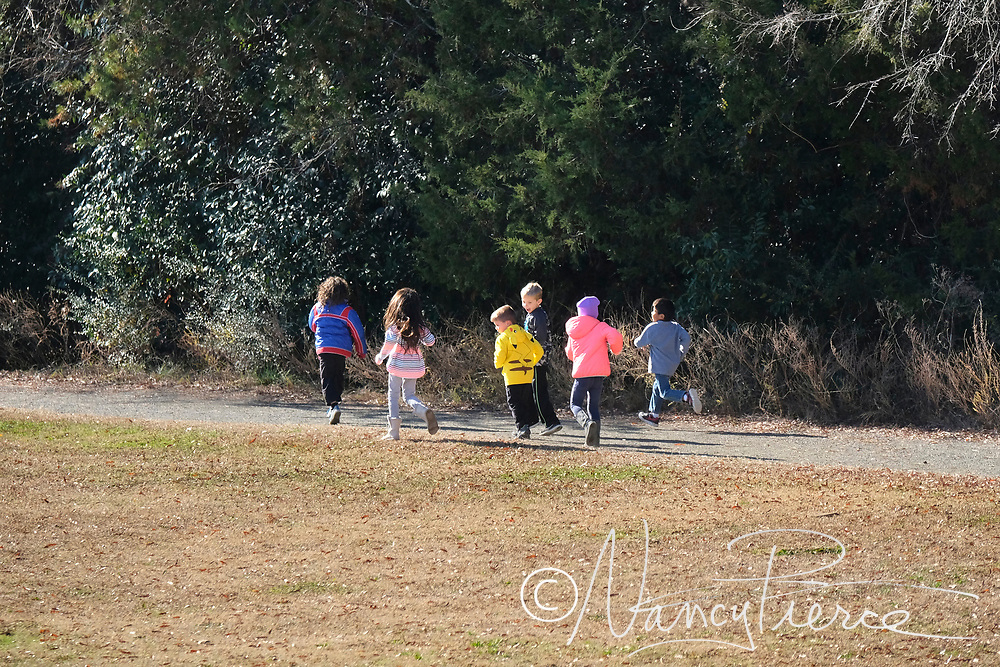 """Smithfield students are encouraged to run every day during recess on the school's track for fitness, and teachers keep track of their laps. Students are recognized for each 25 miles, and some attain membership in the """"100 Mile Club"""""""