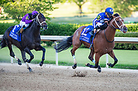 HOT SPRINGS, AR - MAY 02:  Jockey Gabriel Saez rides #12 By My Standards to the lead past Jockey Florent Geroux rides #6 Warrior's Charge during The Oaklawn Handicap at Oaklawn Racing Casino Resort on Derby Day during the Covid-19 Pandemic on May 2, 2020 in Hot Springs, Arkansas. (Photo by Wesley Hitt/Getty Images)