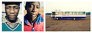 Two boys pose as they start working in the morning at the bus station of Irene, Johannesburg.<br />