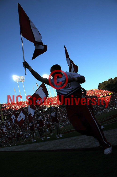 NC State cheerleader celebrates a Wolfpack touchdown during the WCU football game. PHOTO BY ROGER WINSTEAD