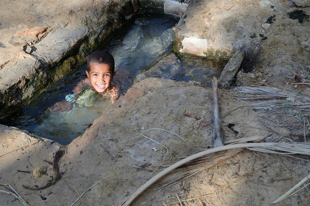 A Siwan boy cools off in the kiddie pool at Fatnas Spring, in Siwa