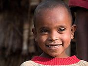 Murta, Molla's son, outside his family home in Boreda, Ethiopia.