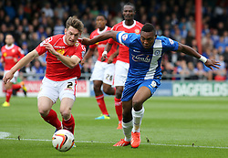 Crewe's Matt Tootle battles with Peterborough United's Britt Assombalonga  - Photo mandatory by-line: Joe Dent/JMP - Tel: Mobile: 07966 386802 07/09/2013 - SPORT - FOOTBALL -  Alexandra Stadium - Crewe - Crewe Alexandra V Peterborough United - Sky Bet League One
