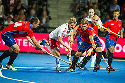England's Ashley Jackson drives into the circle past Aleksandr Cherenkov and Sergei Spichkovskll of Russia. England v Russia - Unibet EuroHockey Championships, Lee Valley Hockey & Tennis Centre, London, UK on 21 August 2015. Photo: Simon Parker