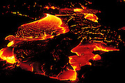 Surface lava flowing at night, Hawaii Volcanoes National Park, The Big Island, Hawaii