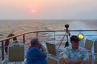 Jon and Rob waiting for sunset on Deck 6 of the M/V Explorer. UTW-II  2011 Spring Enrichment Voyage. Image taken with a Leica X1 (ISO 100, 24 mm, f/4.5, 1/160 sec).