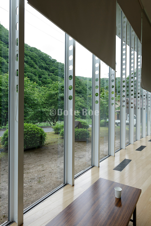 large windows looking out on to a mountainous landscape