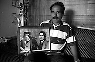 Rome   Septenber 1999.Macedonian rom  shows pictures of parents, in the Rom's camp  Casilino 700.