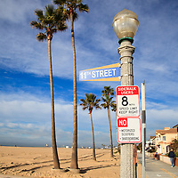 Photo of 11th Street sign along the Newport Balboa Bike Trail on Balboa Peninsula in Newport Beach California. Newport Beach is a beach community along the Pacific Ocean in Orange County Southern California.