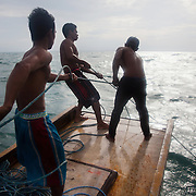 Its a tough pull and the crew has got a lot of rope to haul before the first fish show. Joseph is 17 and works like his father did on the sea as a fisherman. The catch of the day is hauled in by the entire crew to be sorted out on deck and taken straight to the market in Hinigaran. The catch that day made the crew $12.00 each( Captain Joan $24.00) One day a week Joseph goes to Alternative Learning schooling provided by Quidan-Kaisahan.  Quidan-Kaisahan is a charity working in Negros Occidental in the Philippines. Their aim is to keep children out of work to secure them education.