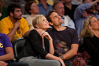 27 October 2009: Actress Charlize Theron and actor Stuart Townsend enjoy an NBA basketball game during the first half of the Los Angeles Lakers 99-92 victory over the Los Angeles Clippers at the STAPLES Center in Los Angeles, CA.