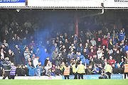 Oldham Athletic fans let off smoke bombs during the EFL Sky Bet League 2 match between Grimsby Town FC and Oldham Athletic at Blundell Park, Grimsby, United Kingdom on 15 September 2018.