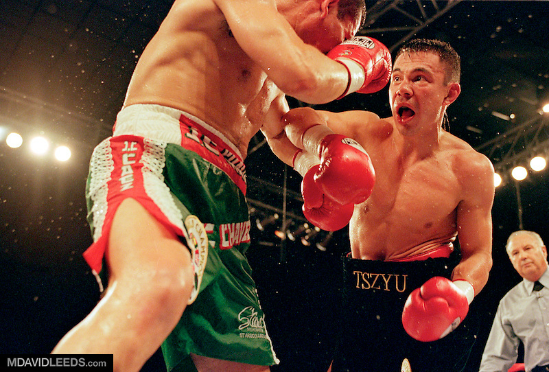 29 Jul 2000:  Kostya Tszyu advancs on Julio Cesar Chavez during the WBC Super Lightweight Championship fight at the Veterans Memorial Coliseum in Phoenix, Arizona.  Tszyu won by TKO in the sixth round.<br /> Mandatory Credit: M David Leeds  /Allsport