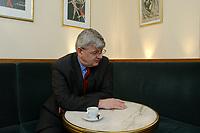 20 MAR 2003, BERLIN/GERMANY:<br /> Joschka Fischer, B90/Gruene, Bundesaussenminister, waehrend einem Interview, Cafe am Schiffbauerdamm<br /> Joschka Fischer, Green Party, Minister of foreign affairs, during an interview<br /> IMAGE: 20030320-01-025