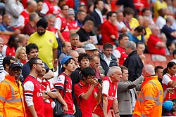 Arsenal fans during pre match warm up  - Photo mandatory by-line: Mitch Gunn/JMP - Tel: Mobile: 07966 386802 17/08/2013 - SPORT - FOOTBALL - Emirates Stadium - London -  Arsenal V Aston Villa - Barclays Premier League