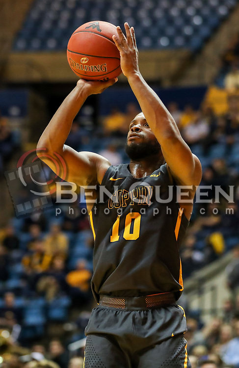 Dec 20, 2017; Morgantown, WV, USA; Coppin State Eagles guard Karonn Davis (10) shoots the ball during the first quarter against the West Virginia Mountaineers at WVU Coliseum. Mandatory Credit: Ben Queen-USA TODAY Sports