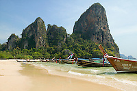 Longtail boats on Railay Beach West Andaman Sea below what is called the Thaiwand Wall rock formation South Thailand&#xA;<br />