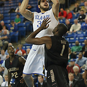 Delaware Forward Carl Baptiste (33) shoot over College of Charleston Forward Adjehi Baru (1) in the first half of a NCAA regular season Colonial Athletic Association conference game between Delaware and The College of Charleston Wednesday, Feb 5, 2014 at The Bob Carpenter Sports Convocation Center in Newark Delaware.