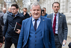 © Licensed to London News Pictures. 22/03/2019. London, UK. SNP Westminster Leader Ian Blackford (centre) arrives at the Cabinet Office in Westminster. The EU27 have agreed to Prime Minister Theresa May's request for a short extension to the deadline for leaving the European Union, offering two new deadlines depending on whether she is able to pass her deal next week. Photo credit: Rob Pinney/LNP