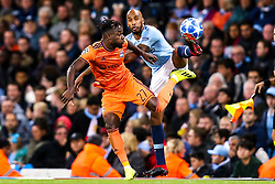 Fabian Delph of Manchester City challenges Maxwel Cornet of Lyon - Mandatory by-line: Robbie Stephenson/JMP - 19/09/2018 - FOOTBALL - Etihad Stadium - Manchester, England - Manchester City v Lyon - UEFA Champions League Group F