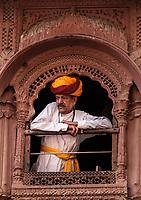 JODHPUR, INDIA - CIRCA NOVEMBER 2016:  Indian man in typical Rajasthani cloth a the Mehrangarh Fort in Jodphur