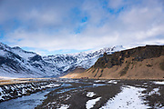 Dwellings and volcanic moraine under Eyjafjallajokull glacier famous for major volcanic eruption, Thorsmork Valley, Katla Geopark South Iceland