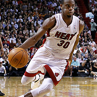 24 January 2012: Miami Heat point guard Norris Cole (30) dribbles during the Miami Heat 92-85 victory over the Cleveland Cavaliers at the AmericanAirlines Arena, Miami, Florida, USA.