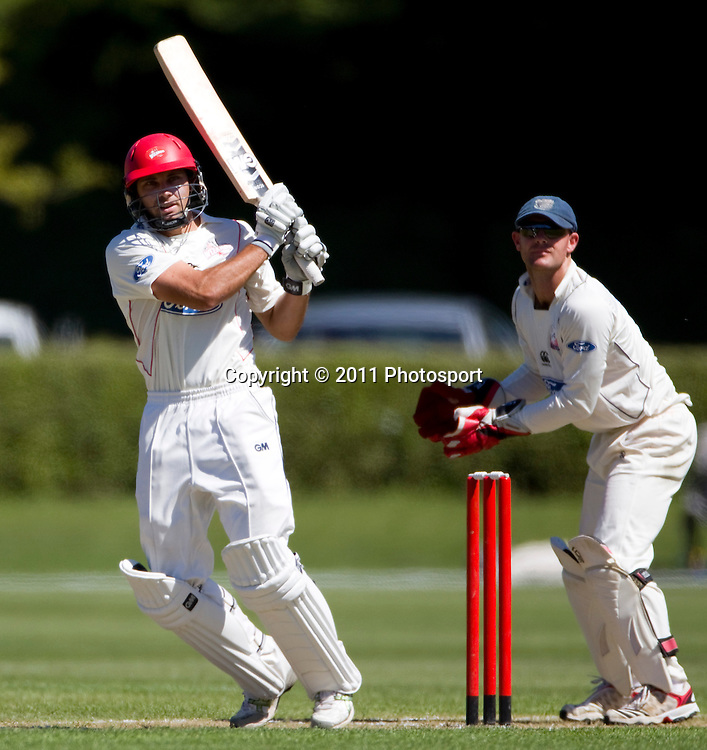Canterbury batsman Dean Brownlie and Auckland wicket keeper Gareth Hopkins on day 2 of the 4 Day Plunket Shield cricket match between the Canterbury Wizards and Auckland Aces. Played on MainPower Oval in Rangiora, Canterbury. Tuesday 15 November 2011. Joseph Johnson/photosport.co.nz